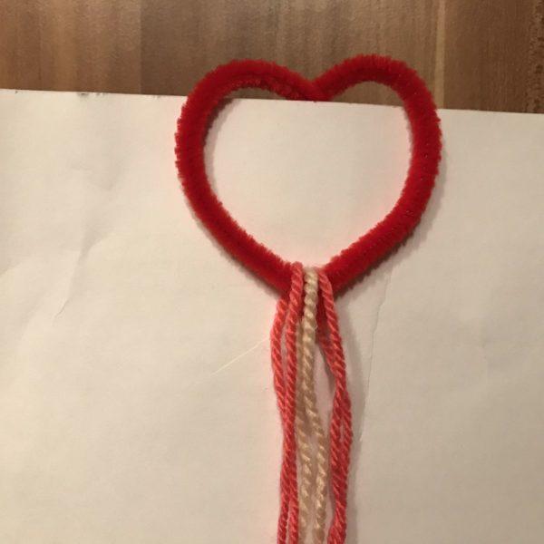 Fäden durch das Herz fädeln